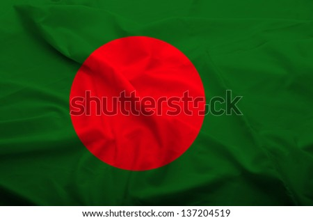 Waving flag of Bangladesh. Flag has real fabric texture. - stock photo