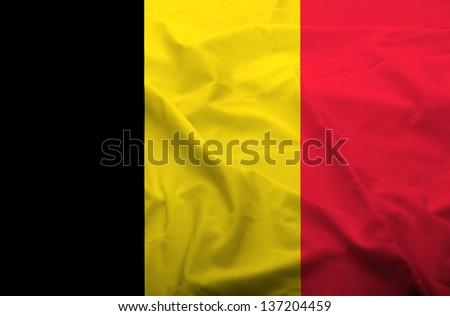 Waving flag of Belgium. Flag has real fabric texture. - stock photo