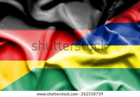 Waving flag of Bhutan and Germany - stock photo