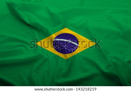 Waving flag of Brasil. Flag has real fabric texture. - stock photo