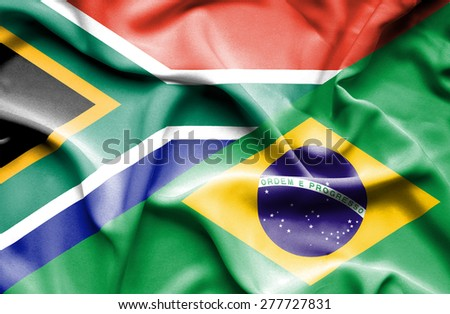 Waving flag of Brazil and South Africa - stock photo