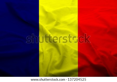 Waving flag of Chad. Flag has real fabric texture.