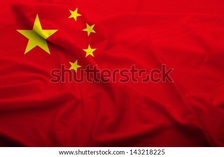 Waving flag of China. Flag has real fabric texture.  - stock photo