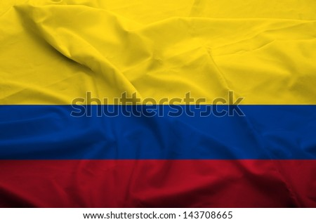 Waving flag of Colombia. Flag has real fabric texture.  - stock photo