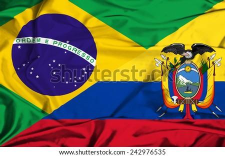 Waving flag of Ecuador and Brazil - stock photo