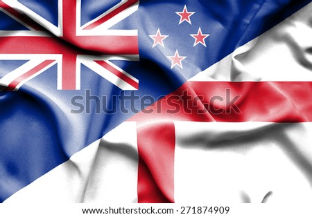 Waving flag of England and New Zealand - stock photo