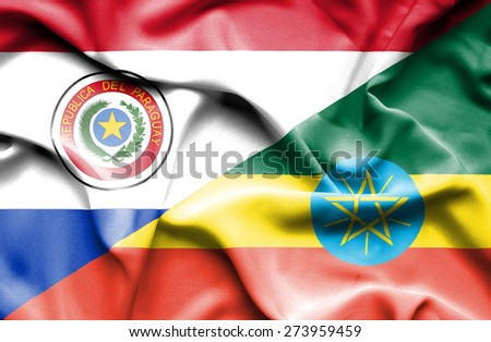 Waving flag of Ethiopia and Paraguay - stock photo
