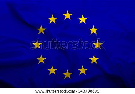 Waving flag of EU. Flag has real fabric texture. - stock photo