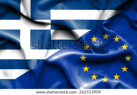 Waving flag of European Union and Greece - stock photo