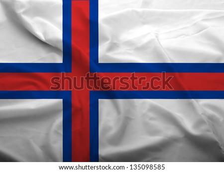 Waving flag of Faroe Island. Flag has real fabric texture. - stock photo