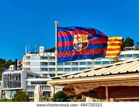 Waving flag of FCB (Futbol Club Barcelona). Tossa de Mar town. Catalonia, Spain