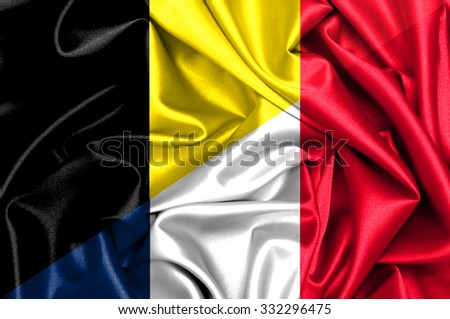 Waving flag of France and Belgium  - stock photo