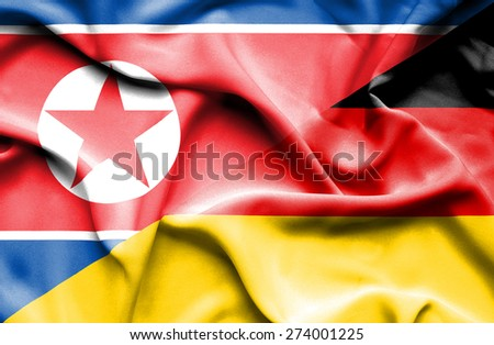 Waving flag of Germany and North Korea - stock photo