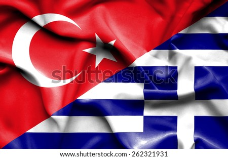 Waving flag of Greece and Turkey - stock photo