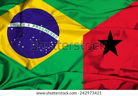Waving flag of Guinea Bissau and Brazil