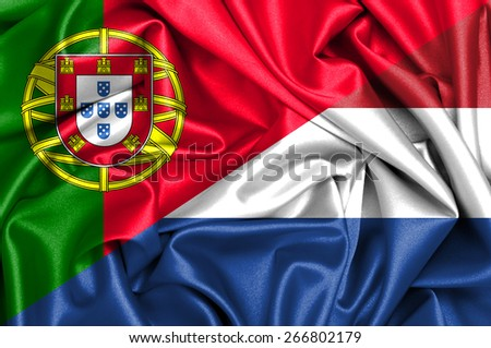 Waving flag of Holland and Portugal - stock photo