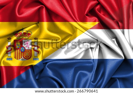Waving flag of Holland and Spain - stock photo