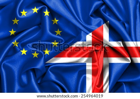 Waving flag of Iceland and EU - stock photo