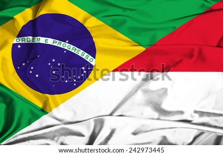 Waving flag of Indonesia and Brazil - stock photo