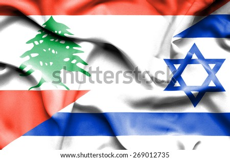 Waving flag of Israel and  Lebanon - stock photo
