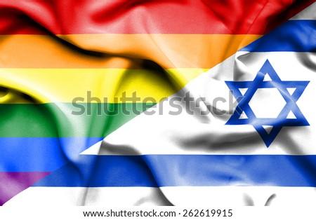 Waving flag of Israel and LGBT - stock photo