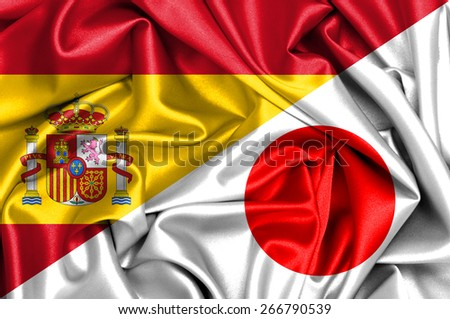 Waving flag of Japan and Spain - stock photo