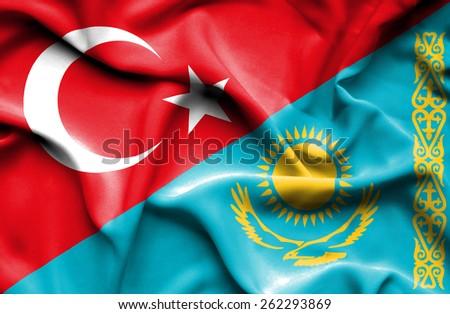 Waving flag of Kazakhstan and Turkey - stock photo