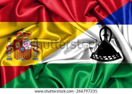 Waving flag of Lesotho and Spain - stock photo