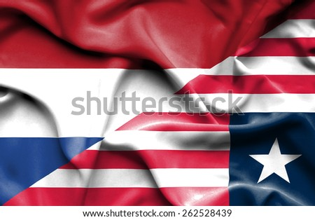 Waving flag of Liberia and Netherlands