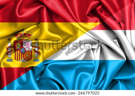 Waving flag of Luxembourg and Spain - stock photo