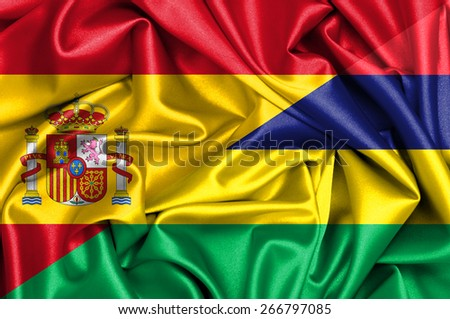 Waving flag of Mauritius and Spain - stock photo