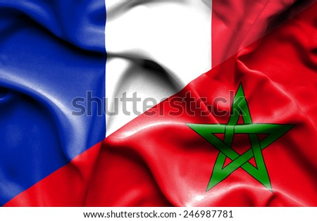 Waving flag of Morocco and France - stock photo