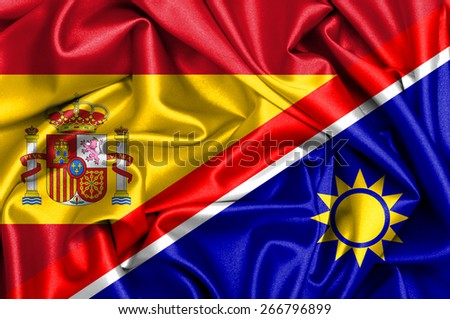 Waving flag of Namibia and Spain - stock photo