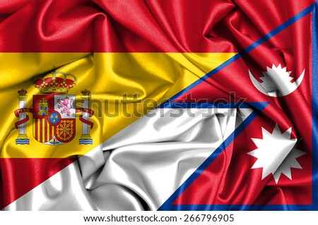 Waving flag of Nepal and Spain - stock photo
