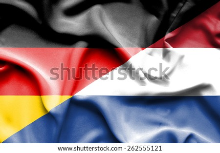 Waving flag of Netherlands and Germany - stock photo