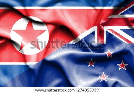 Waving flag of New Zealand and North Korea