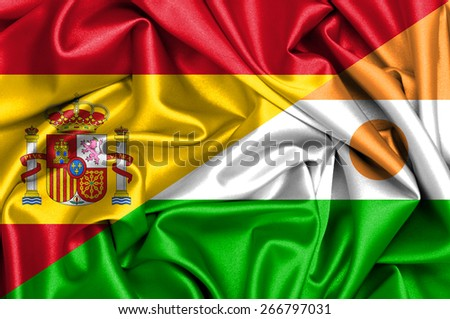 Waving flag of Niger and Spain - stock photo