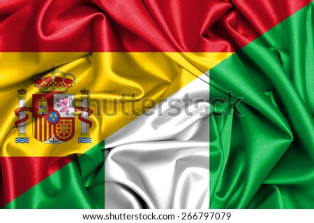 Waving flag of Nigeria and Spain - stock photo
