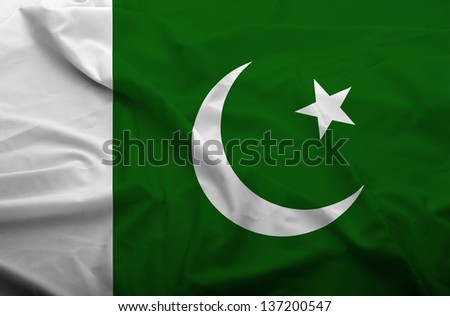 Waving flag of Pakistan. Flag has real fabric texture.
