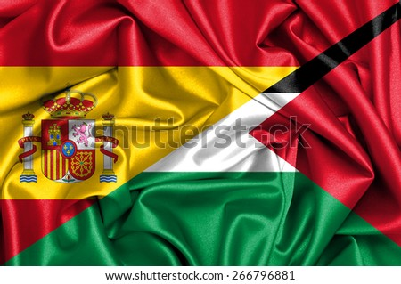 Waving flag of Palestine and Spain - stock photo