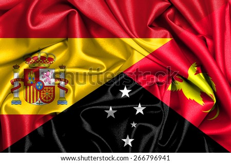 Waving flag of Papua New Guinea and Spain