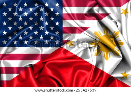 Waving flag of Philippines and USA - stock photo
