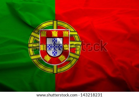 Waving flag of Portugal. Flag has real fabric texture. - stock photo