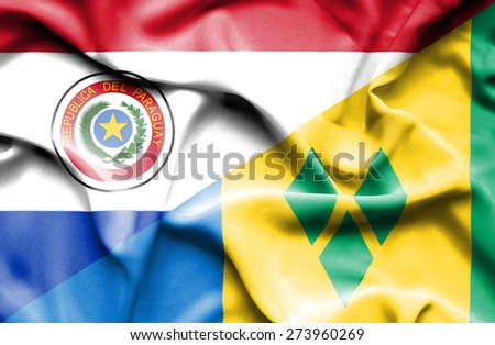 Waving flag of Saint Vincent and Grenadines and Paraguay
