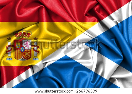 Waving flag of Scotland and Spain - stock photo