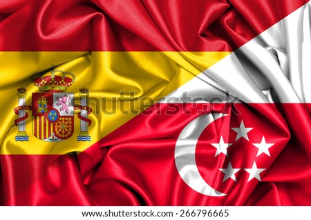 Waving flag of Singapore and Spain - stock photo
