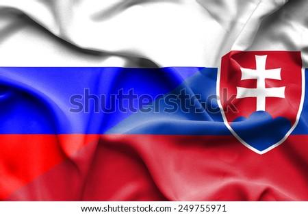 Waving flag of Slovakia and Russia - stock photo