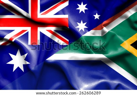 Waving flag of South Africa and Australia - stock photo
