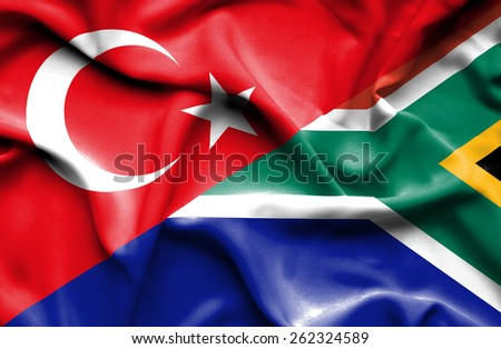 Waving flag of South Africa and Turkey - stock photo
