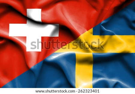 Waving flag of Sweden and Switzerland - stock photo